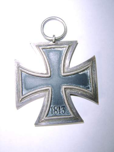 What is my ww2 iron cross, hat pin and badge worth?