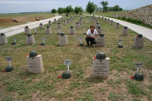 Valary Strykov with Russian war dead he identified in the Kessel.jpg