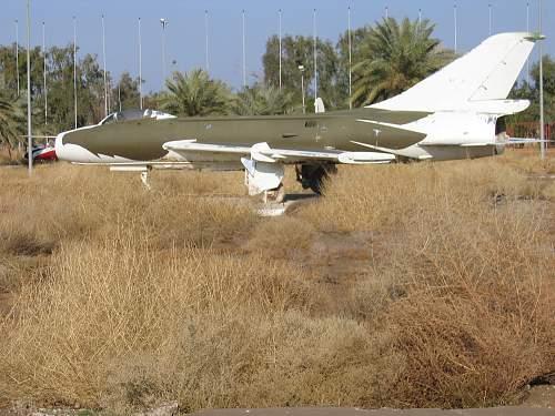 Pile of Helmets & MIG jet seen in Iraq