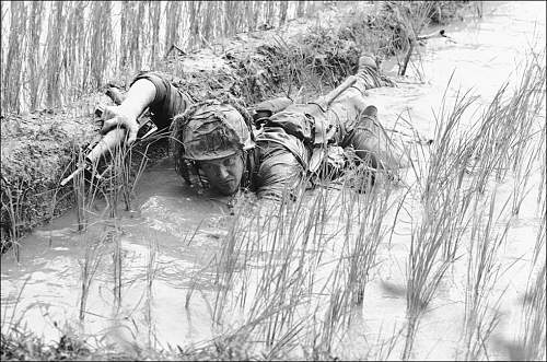 1966 Pfc. Lacey Skinner ,crawls through the mud of a rice paddy avoiding heavy Viet Cong fire ne.jpg