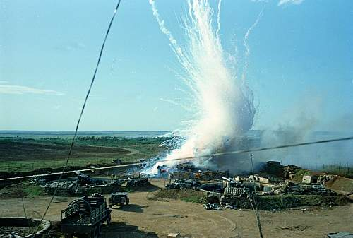 A North Vietnam ese 122 mm shell explodes in a direct hit on a U.S. ammunition bunker of 175 mm .jpg