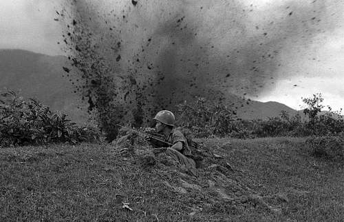 a South Vietnamese photographer made this picture of a South Vietnamese trooper dug in at Hai Va.jpg