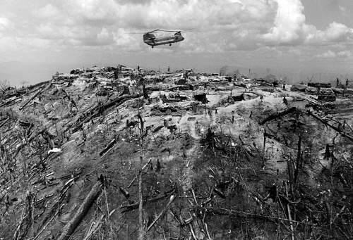 A supply helicopter comes in for a landing on a hilltop forming part of Fire Support Base 29, we.jpg