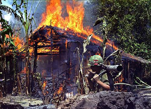 A Viet Cong base camp is torched near My Tho, Vietnam on April 5th, 1968. In the foreground is P.jpg