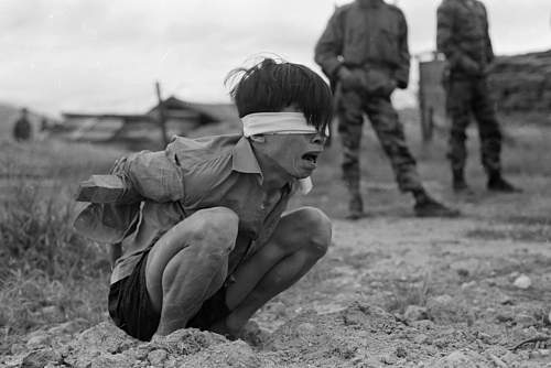 A Viet Cong prisoner awaits interrogation at the A-109 Special Forces Detachment in Thuong Duc, .jpg