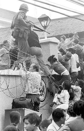 April 29, 1975, people try to scale the 14-foot wall of the U.S. Embassy in Saigon, trying to re.jpg
