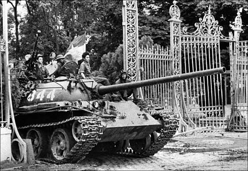 April 30, 1975, a North Vietnamese tank rolls through the gate of the Presidential Palace in Sai.jpg
