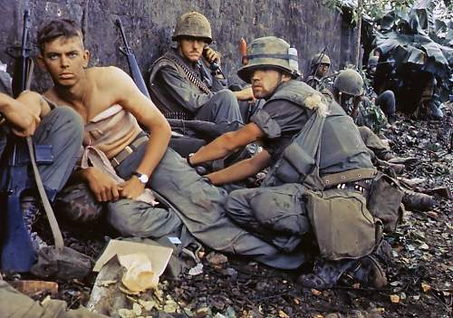 D. R. Howe (Glencoe, MN) treats the wounds of Private First Class D. A. Crum (New Brighton, PA),.jpg