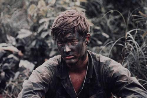 During Operation Bushmaster, a member of Company L, 75th Infantry, wearing camouflage makeup sit.jpg