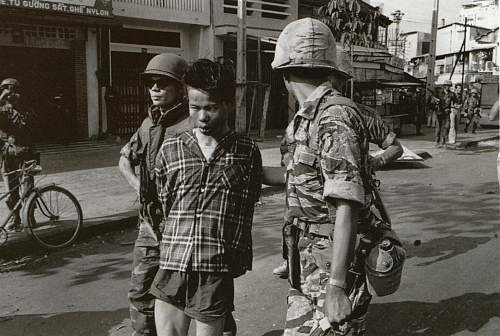 South Vietnamese forces escort suspected Viet Cong officer Nguyen Van Lem (also known as Bay Lop.jpg