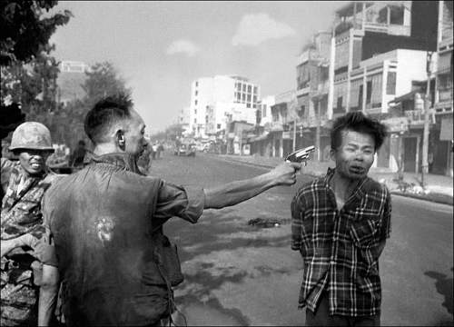 Feb. 1, 1968, South Vietnamese Gen. Nguyen Ngoc Loan, chief of police, fires his pistol into the.jpg
