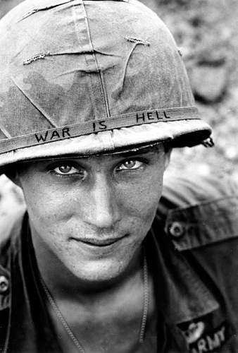 June 18, 1965, an unidentified U.S. Army soldier wears a hand lettered War Is Hell slogan on his.jpg