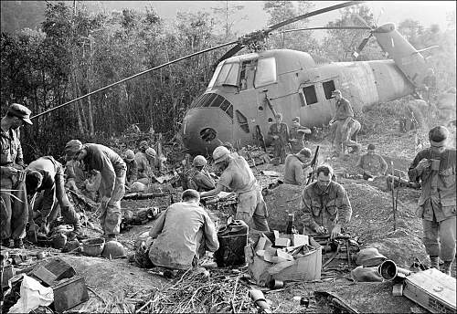 Sept. 21, 1966,U.S. Marines emerge from their muddy foxholes at sunrise after a third night of f.jpg
