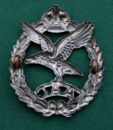Your opinions on this AAC cap badge please