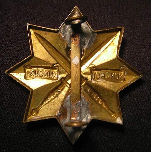 Dutch wwii or interwar period commando cap badge?