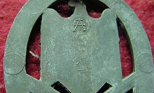 Two Allgemeine Sturmabzeichen: Authentic Pieces? Bronze Finish on Assman?