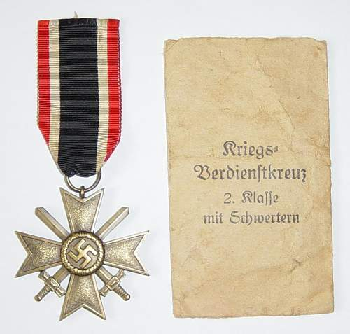 Click image for larger version.  Name:War Merit Cross 2nd class with packet of issue..JPG Views:145 Size:119.4 KB ID:73485