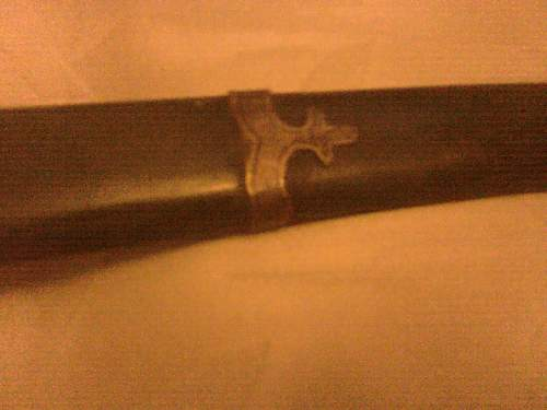 chinese/japenes sword. could anyone identify it for me please