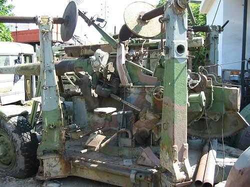 A  3,7 inch  A/A GUN  in a Military Surplus Yard
