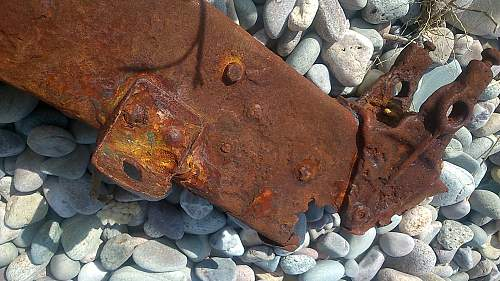 sizeable rusty metal piece washed up...