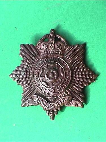 Some idea about this english cap badge?