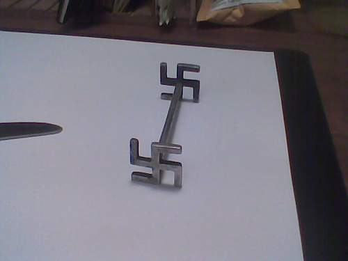 Swastika knife rest.