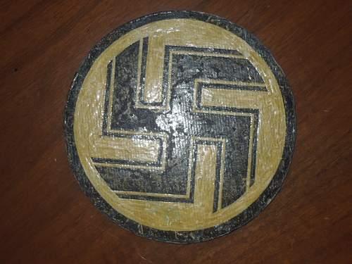 Plaque with swastikas (fiberglass?)