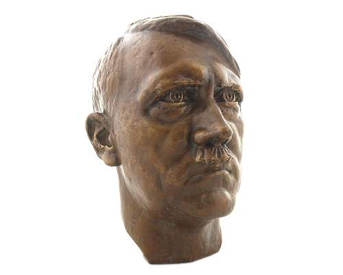 Cleaning bronze bust