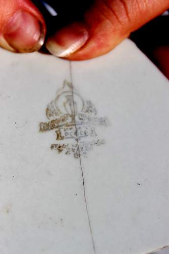 German porcelain fragments  and makers marks on other items  from conflict archaeology excavation in Finland