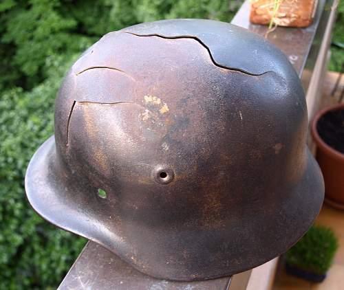 relic helmet wit black paint and battle damaged?