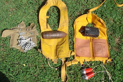 2 mae wests, n-6 gun camera and 75mm apt shell, yard sale