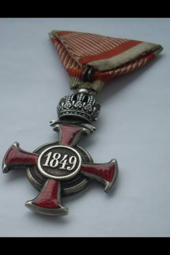 Austro Hungarian Franz Joseph Silver Merit Cross with Crown on War Ribbon with Swords.