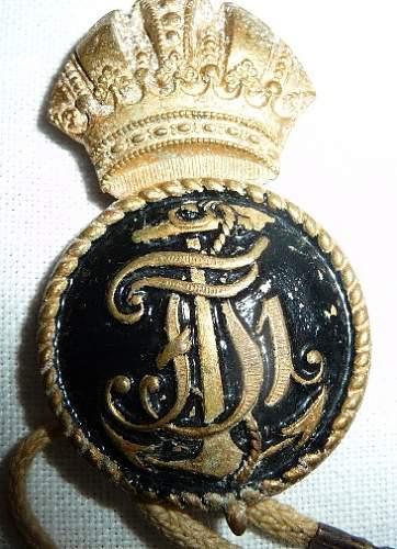 Shoulder strap and badge