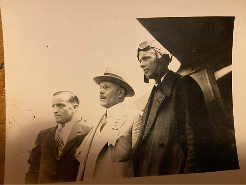 Who are the two men on the left in this photo?