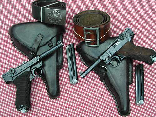 Click image for larger version.  Name:1937 and 1938  S 42  P08s both have two matching magazines holsters.jpg Views:1263 Size:267.7 KB ID:74011