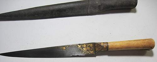 Need help ID'ing a possible hunting knife...