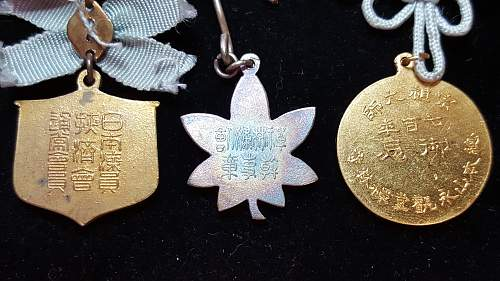 Need help with Asian medals/pins