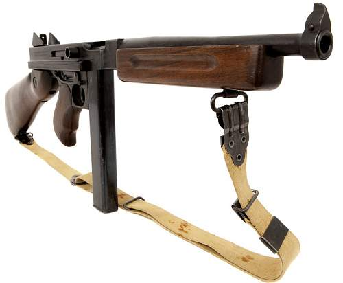 Click image for larger version.  Name:Thompson M1A1 Submachine gun.jpg Views:0 Size:48.3 KB ID:1007466