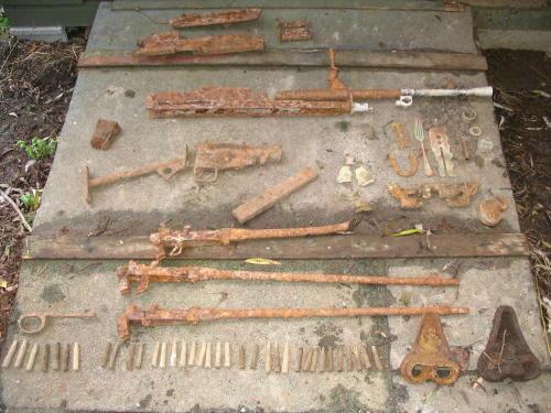 Bren, Sten, 3 x No.4's, brass button stick, fork, bren track link etc....JPG