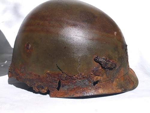 Auxais 83rd Helmet Liner with mortar shrapnel!2.jpg