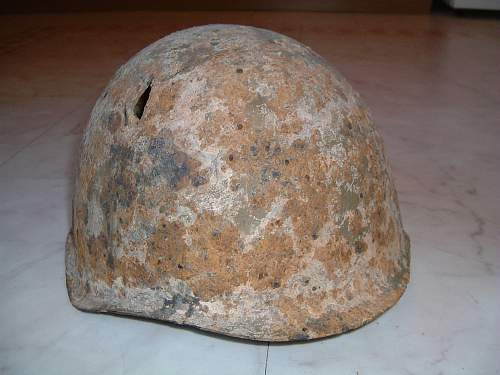 Click image for larger version.  Name:battle damaged russian helmet.jpg Views:4 Size:249.3 KB ID:141285