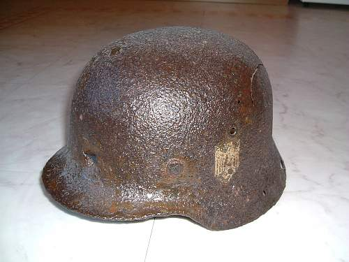 Click image for larger version.  Name:german helmet with bullet hole in front.jpg Views:7 Size:254.7 KB ID:141308