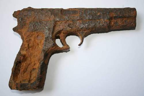 Relic Browning Hi Power, from St Mere Eglise.