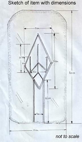 Sottevast V site relic, rocket shaped design marked with runes