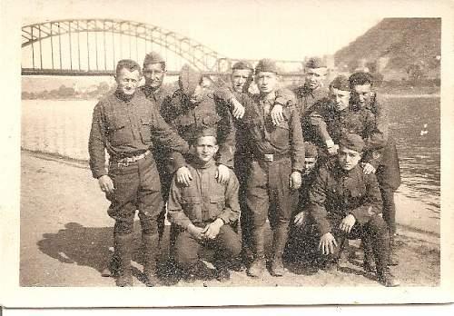 group photo by bridge see man with german belt buckle.jpg