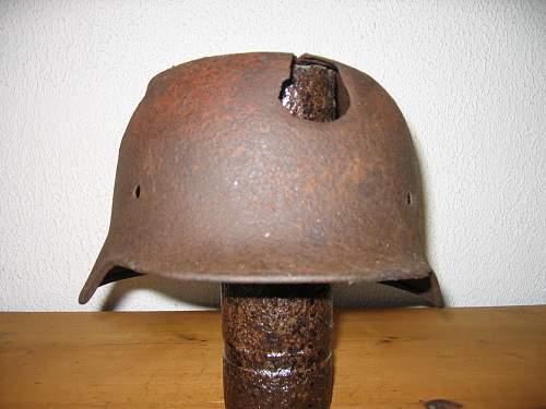 Battle damaged German lids