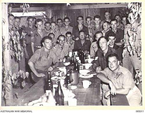 Click image for larger version.  Name:085011 KAIRI, ATHERTON TABLELAND, QUEENSLAND. 1944-12-25. OFFICERS AND SERGEANTS IN THE MEN'S ME.jpg Views:0 Size:230.6 KB ID:639572