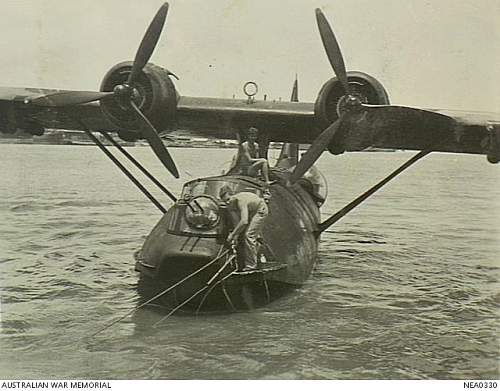 Cairns Qld 1944 0112 The bowman of a RAAF Consolidated PBY Catalina flying boat takes aboard a t.jpg