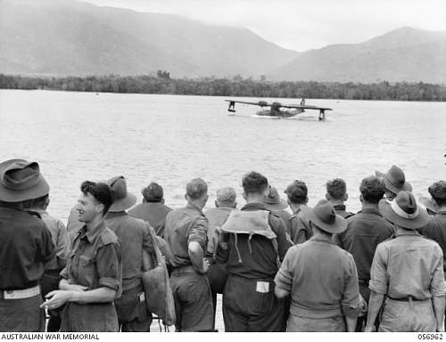 Click image for larger version.  Name:CAIRNS QLD. 1943 09 08. REINFORCEMENTS ABOARD SHIP WATCHING A CATALINA AIRCRAFT WARMING UP FOR A.jpg Views:0 Size:162.5 KB ID:710083