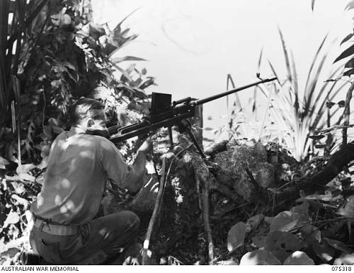 Click image for larger version.  Name:075318  TANK ATTACK RIFLE TO SHOOT CROCODILES IN A SWAMP NEAR THE UNIT CAMP.JPG Views:1 Size:183.2 KB ID:710087